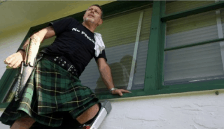clean window men in kilts